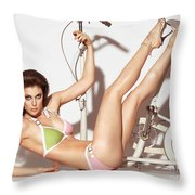 Young Woman In A Swimsuit Posing With Exercise Bike Throw Pillow
