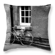 bicycle in Edinburgh close Throw Pillow