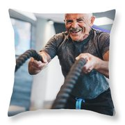 Senior Man Exercising With Ropes At The Gym. Throw Pillow