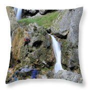Climbers Making Their Way Up The Cliffs Of Gordale Scar Throw Pillow