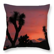 Joshua Trees Silhouetted Against A Red Sky Throw Pillow