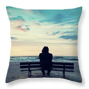 Man In Hood Sitting On A Lonely Bench On The Beach Throw Pillow