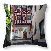 old historic street and woodframed house in Ediger Germany Throw Pillow