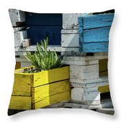 Old Pallet Painted White, Blue And Yellow Used As Flower Pot Throw Pillow