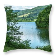 People Use Stand-up Paddleboards On Lake Habeeb At Rocky Gap Sta Throw Pillow