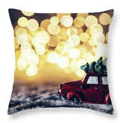 Red Car With Christmas Tree Driving Through Snow Throw Pillow