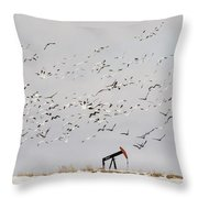 Snow Geese Over Oil Pump 02 Throw Pillow by Rob Graham