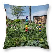 Sticks With Colorful Balls In A Garden Throw Pillow