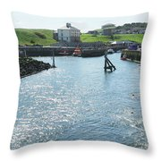 sunlight glistening on water at Eyemouth harbour Throw Pillow