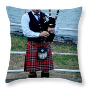 The Lone Piper Throw Pillow