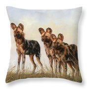 Three African Wild Dogs Throw Pillow