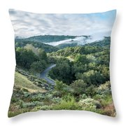 View Of Curved Road Through Dense Forest Area With Low Clouds Ov Throw Pillow