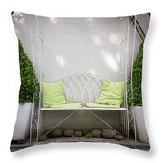 White Bench Made Of Iron With Two Green Bushes On The Side Throw Pillow
