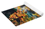 Colorful Fall Leaves Over Blue Water Yoga Mat