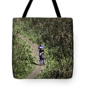 2 Photographers Walking Through Tall Grass Tote Bag