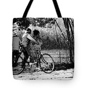 3 Young Children On A Cycle At The Side Of The Road Tote Bag