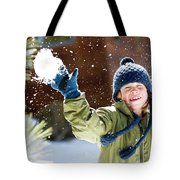 A Boy Throws A Snowball While Playing Tote Bag