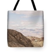 A Hiker Stands On A Peak Tote Bag