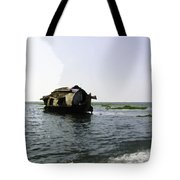 A Houseboat Moving Placidly Through A Coastal Lagoon In Alleppey Tote Bag