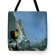 A Man Backpacks In Front Of Fitz Roy Tote Bag