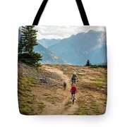 A Mother And Daughter Mountain Biking Tote Bag