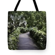 A Raised Walking Path Inside The National Orchid Garden In Singapore Tote Bag