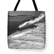 A Snowmobiler Jumping Off A Cornice Tote Bag