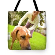 A Woman Gives Her Rhodesian Ridgeback Tote Bag
