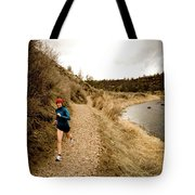 A Woman Jogging On A Dirt Trail Tote Bag