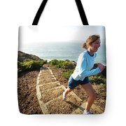 A Woman Running Stairs Near The Ocean Tote Bag