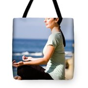 A Women Meditates On The Beach Tote Bag