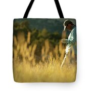 A Young Man Fly-fishing At Sunset Tote Bag