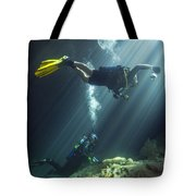 A Young Married Couple Scuba Diving Tote Bag by Michael Wood