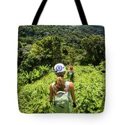A Young Woman Hikes Through The Jungles Tote Bag