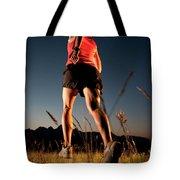 A Young Woman Runs Through A Grassy Tote Bag