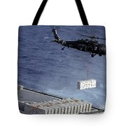 An Mh-60s Sea Hawk Helicopter Picks Tote Bag
