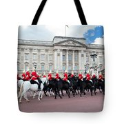 British Royal Guards Perform The Changing Of The Guard In Buckingham Palace Tote Bag