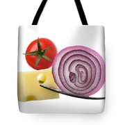 Cheese Onion And Tomato On Forks Against White Tote Bag