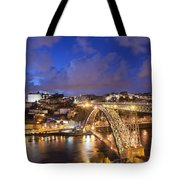 City Of Porto In Portugal By Night Tote Bag