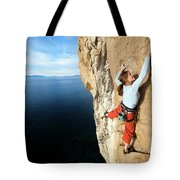 Climber Grabs A Hold While Climbing Tote Bag
