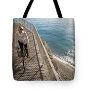 Elevated Perspective Of Woman Riding Tote Bag