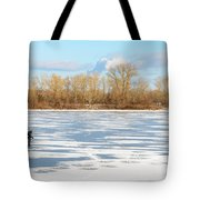 Fisherman On The Frozen River Tote Bag