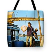 Fisherman With A Skate On Thu Bon River In Hoi An-vietnam  Tote Bag