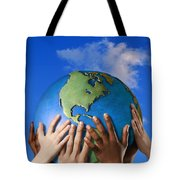 Hands On A Globe Tote Bag