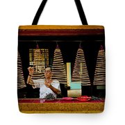 Man Lighting Incense In Chinese Temple Vietnam Tote Bag