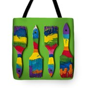 Multicolored Paint Brushes On Green Background Tote Bag