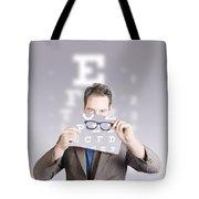 Optometrist Or Vision Doctor Holding Eye Glasses Tote Bag
