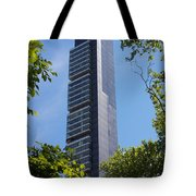 Skyscraper Rising Among Trees Of Madison Square Park Tote Bag