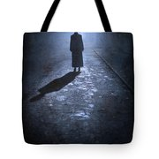 Woman Alone Outside In Fog At Night Tote Bag