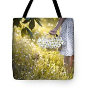 Woman Picking Flowers In A Wild Flower Meadow Tote Bag